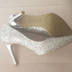 Silver high heels size 9